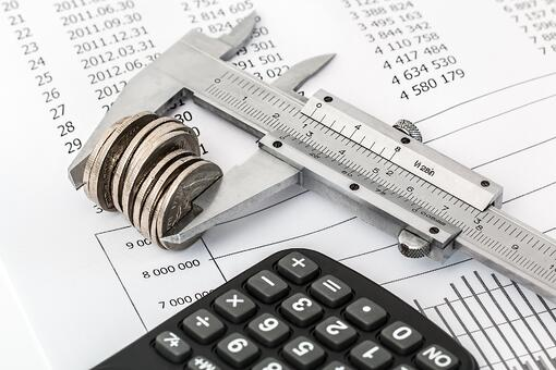 Money being measured by vernier calipers